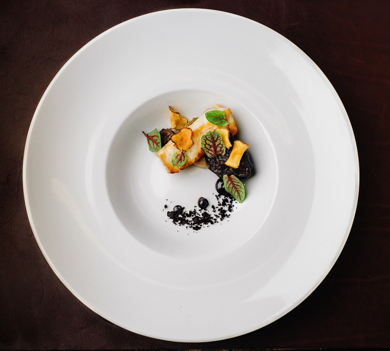 Sturgeon, black olive and sun choke prepared by Chefs William Preisch and Joel Stocks of Hold Fast Dining