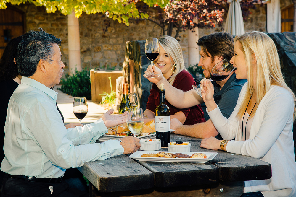 Guests enjoying a picnic lunch and wine at Sebastiani Vineyard and Winery in Sonoma, California