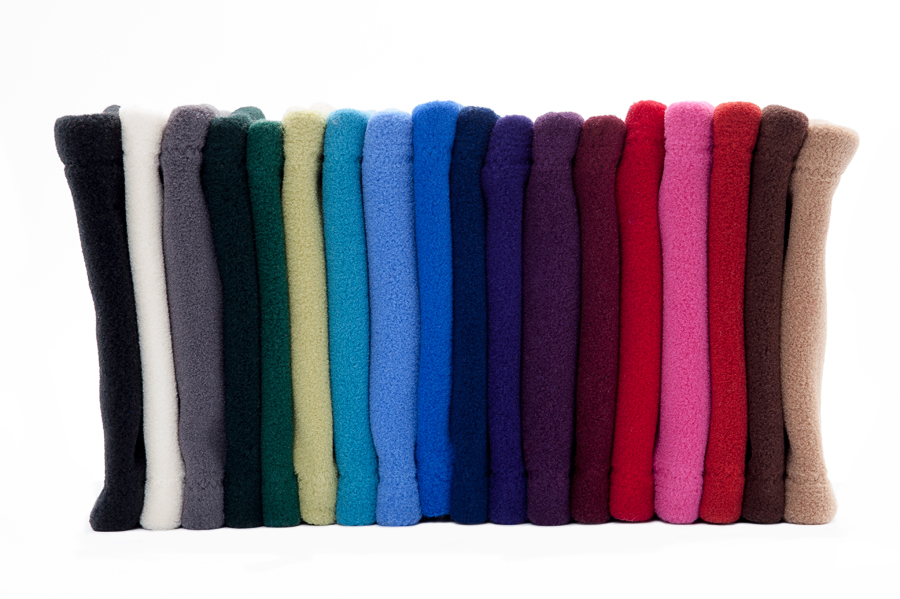 Many Weathers collection of fleece neckwarmers in a variety of beautiful colors on a white background