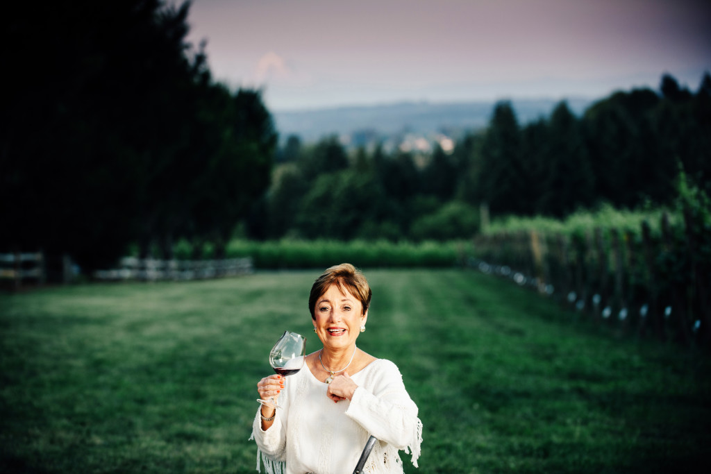 Sheila Blakeslee of Blakeslee Vineyard Estates at sunset with Mt. Hood as the backdrop