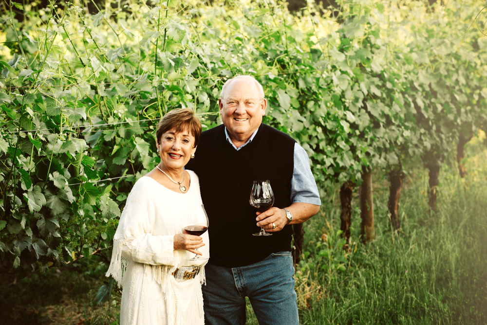 Sheila and Bill Blakeslee owner of Blakeslee Vineyard Estates with their vines.