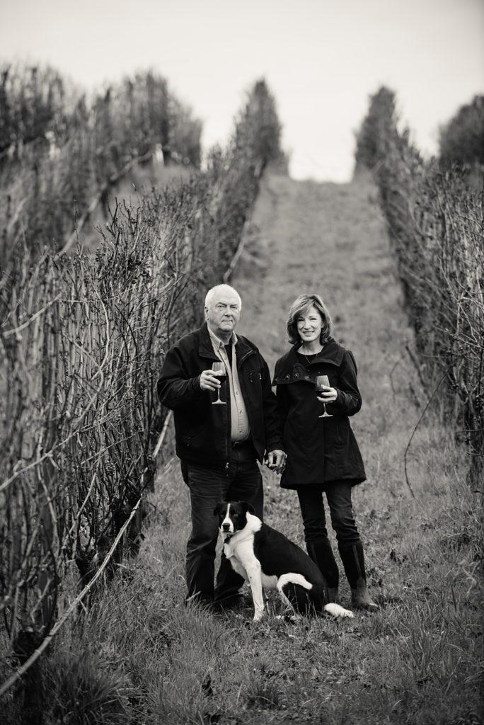 Dave Grooters and Robin Russell walking through the vineyard at Carlton Cellars Vineyard and farm at Carlton Cellars