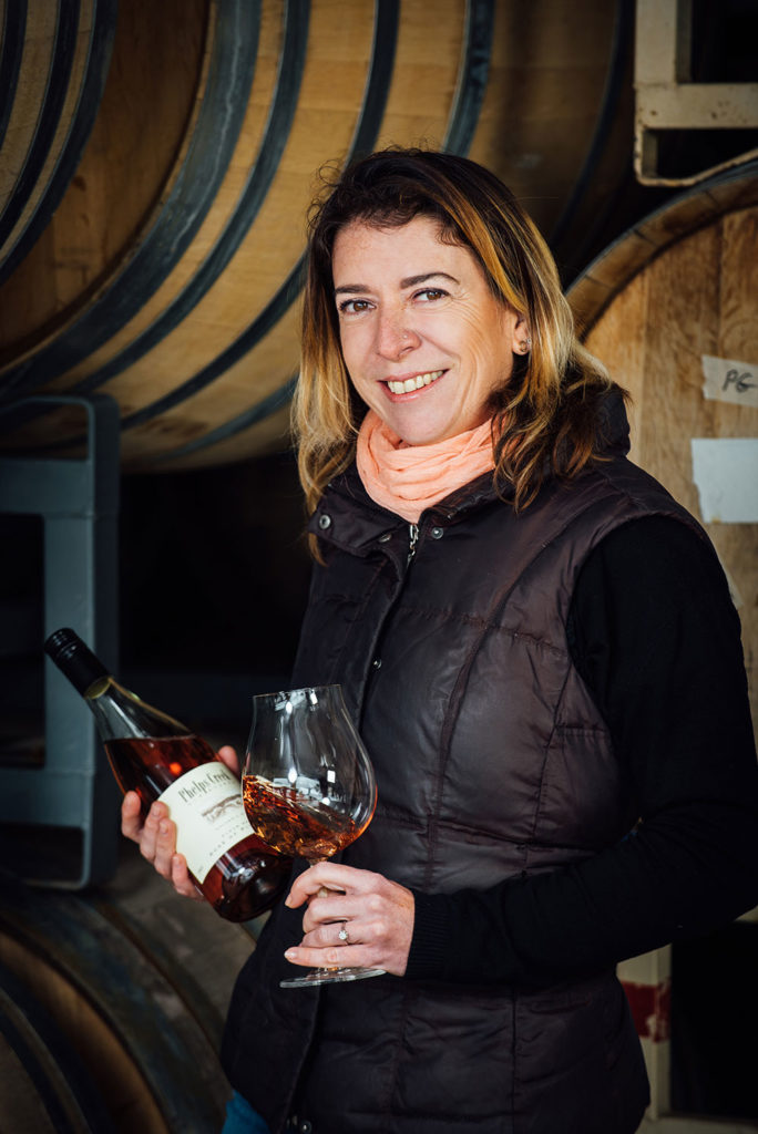 Portrait of winemaker Alexandrine Roy with her Phelps Creek Rose at Phelps Creek Vineyards in Hood River, Oregon.