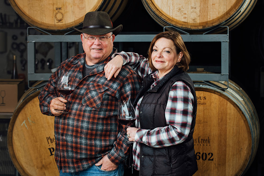 Bob Morus and Lynette Barss Morus owners of Phelps Creek Vineyards in their production area at the winery in Hood River, Oregon